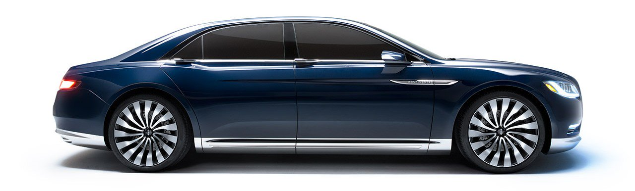 passenger side view of a new blue 2017 lincoln continental